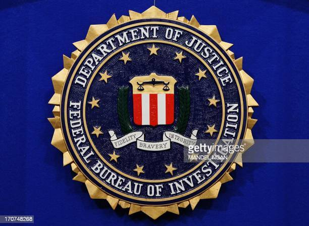 The Federal Bureau of Investigation seal is seen on the lectern following a press conference announcing the FBI's 499th and 500th additions to the...