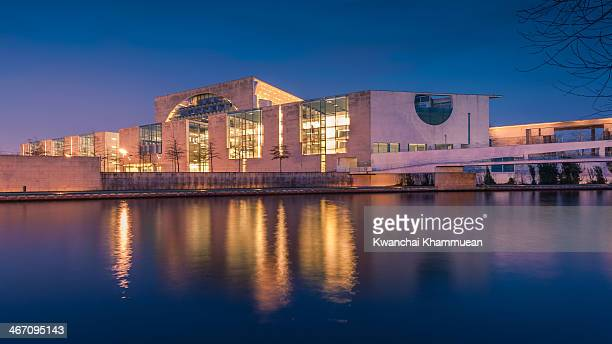 The Federal Chancellery with river Spree. The German Chancellery is a federal agency serving the executive office of the Chancellor, the head of the...