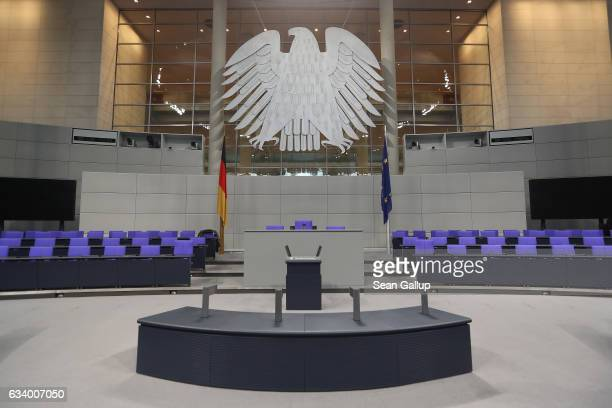 The Federal Eagle hangs over the speaker's pulpit inside the plenary hall of the Bundestag during preparations for the upcoming session of the...