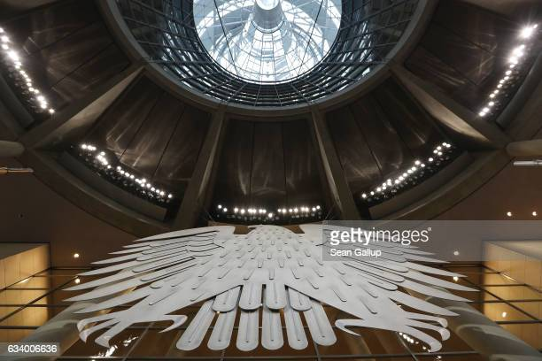 The Federal Eagle hangs under the cupola inside the plenary hall of the Bundestag during preparations for the upcoming session of the Federal...