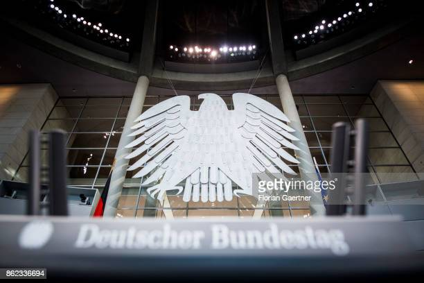 The Federal Eagle is pictured behind the lettering 'Deutscher Bundestag' at the Reichstag on October 17 2017 in Berlin Germany Following German...