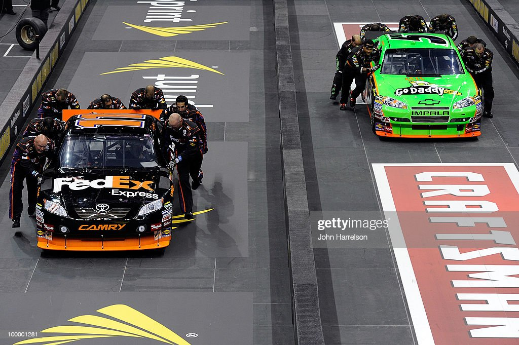 The #11 FedEx Freight Toyota pit crew defeat #5 GoDaddy.com Chevrolet pit crew in the semifinals of the NASCAR Sprint Pit Crew Challenge at Time Warner Cable Arena on May 19, 2010 in Charlotte, North Carolina.