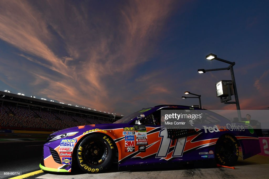 The #11 FedEx Office Toyota, driven by Denny Hamlin (not pictured), waits on pit road prior to qualifying for the Monster Energy NASCAR Cup Series Bank of America 500 at Charlotte Motor Speedway on October 6, 2017 in Charlotte, North Carolina.
