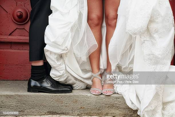 The Feet Of A Bride And Groom