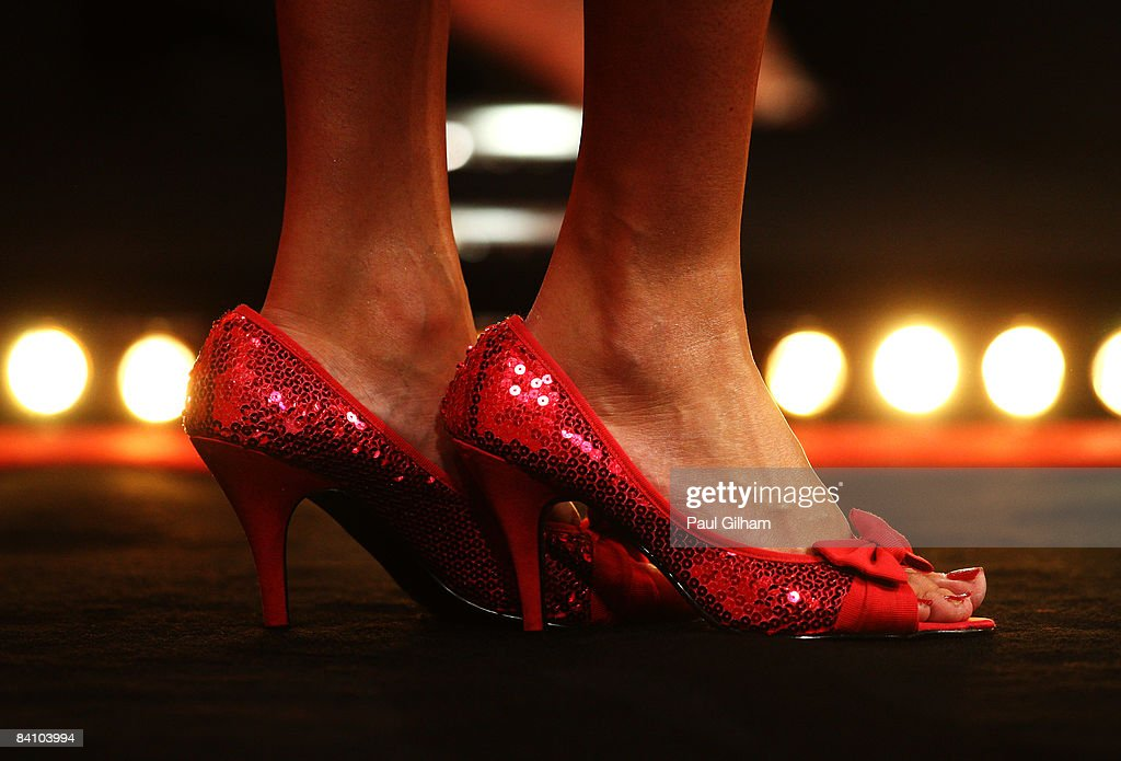 The feet of a glamour girl are seen on the stage prior to the first round match between Peter Manley of England and Mensur Suljovic of Austria during the 2009 Ladbrokes.com PDC World Darts Championship at Alexandra Palace on December 21, 2008 in London, England.