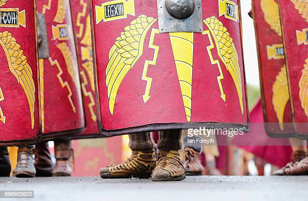 The feet of a Roman soldier can be seen underneath shields as they practice battle drills during the Hadrian's Wall Live event at Housesteads Roman...