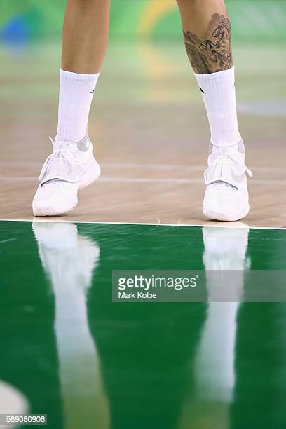 The feet of Cayla George of Australia are seen as she shoots from the free throw line during the Women's round Group A basketball match between...