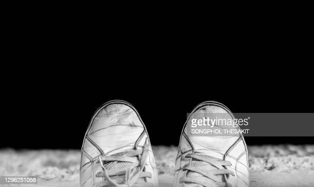 the feet of desperate people standing on a cliff at the bottom are rivers. and below that abyss is death. - suicide stock pictures, royalty-free photos & images