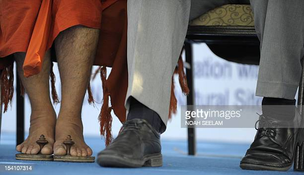 the feet of Hindu religious priest Sri Chinna Jeeyar Swamiji and Executive Secretary Secretariat of the Convention on Biological Diversity Braullo F...