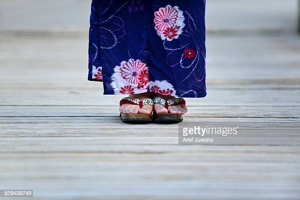 the feet of the girl wearing a yukata - japanese women feet stock photos and pictures