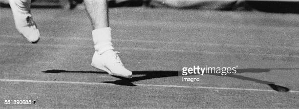 The feet of the tennis player Bunny Austin playing tennis at Wimbledon 24th June 1936 Photograph