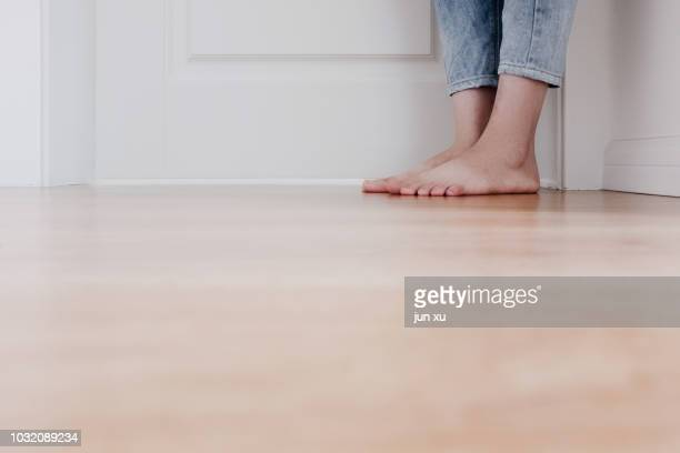 the feet on the wood floor - human leg stock pictures, royalty-free photos & images