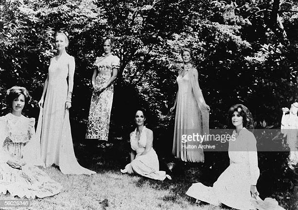 The female cast members of the horror film 'The Stepford Wives' pose for a promotional picture outdoors wearing long flowing dresses 1975 The film...