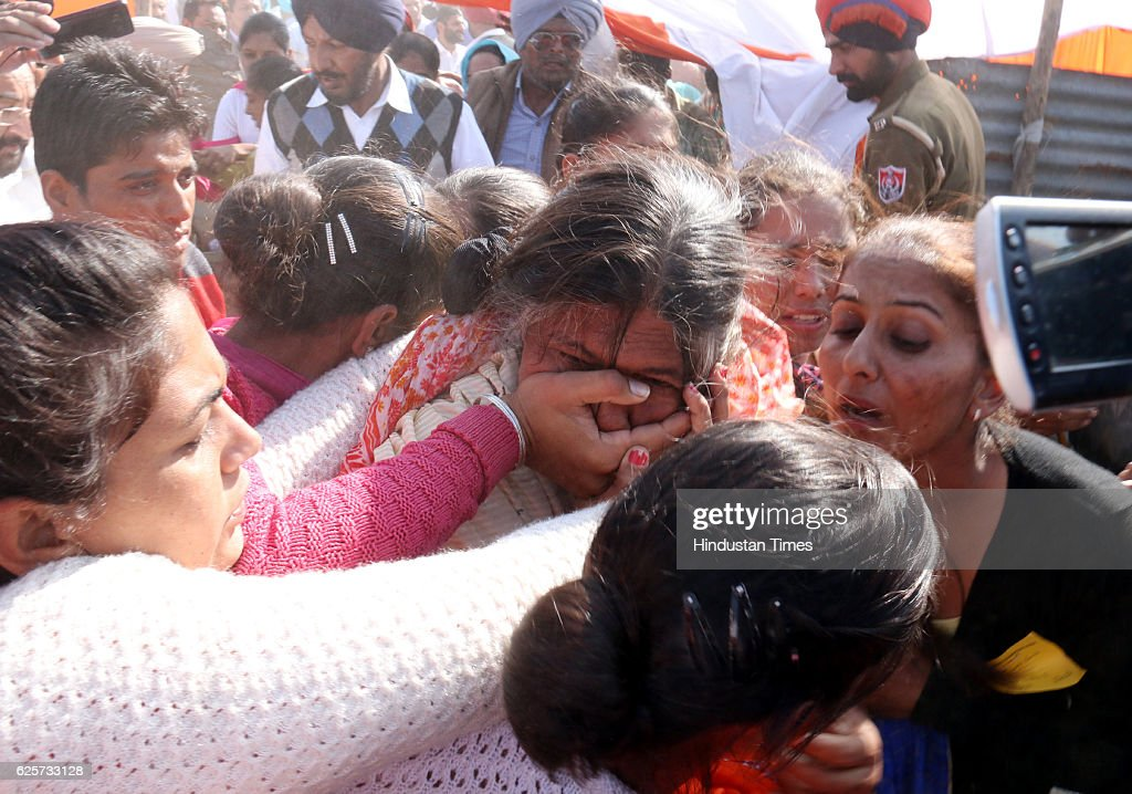 The female constable of Punjab Police in civil dress Rounded up a old women during Prime Minister Narendra Modi speech on lay foundation stone of All.