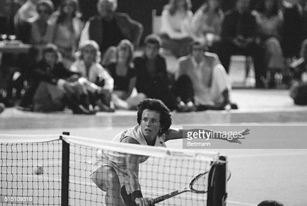 """The female entry in the tennis """"Battle of the Sexes,"""" Billie Jean King is shown in action with Bobby Riggs, , in their winner take all $100,000 match..."""