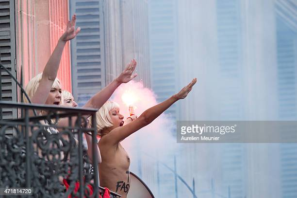 The feminist group, Femen, appeared during the France's far right party the Front National annual rally honoring Joan of Arc on Place de l'Opera, on...