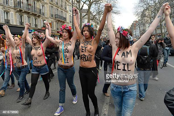 The feminist group Femen demonstrate in Paris today to defend women's rights on January 17 2015 in Paris France Thousands of people walked together...