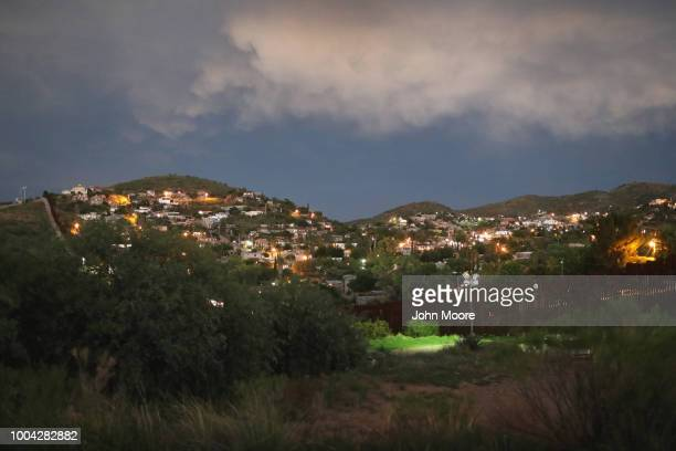 The fence marking the USMexico border is seen at dusk on July 22 2018 in Nogales Arizona President Trump has proposed replacing the fence with a wall