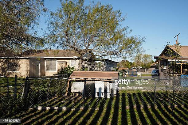 'The Fence' Scenes along the fence line between Brownsville and McAllen Texas on January 14th 2014 Here the shadow of the border fence falls on the...
