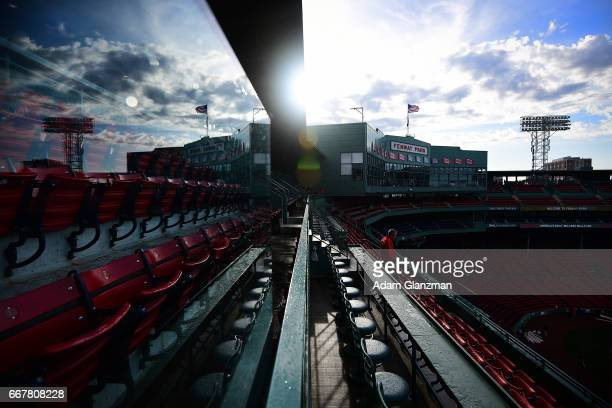 The Fenway Park facade is seen through a reflection before the Boston Red Sox game against the Baltimore Orioles at Fenway Park on April 12 2017 in...