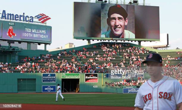 The Fenway Park screens commemorate the 100th anniversary of the birth of Ted Williams before the start of the game The Boston Red Sox host the Miami...