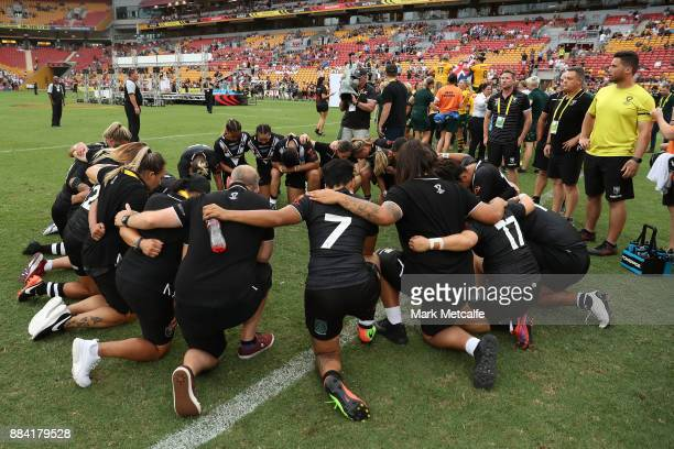 The Ferns embrace in pray after the 2017 Rugby League Women's World Cup Final between Australia and New Zealand at Suncorp Stadium on December 2 2017...