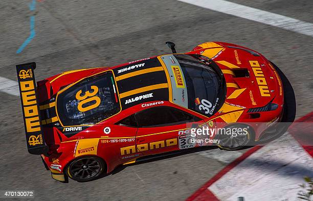 The Ferrari 458 GT3 Italia of Henrique Cisneros races through a turn during practice for the Pirelli World Challenge race at the Toyota Grand Prix of...