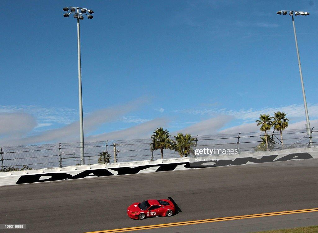 The #55 Ferrari 458 of Michael Waltrip, Robert Kauffman, Clint Bowyer, and Rui Aguas is driven during preseason testing at Daytona International Speedway on January 5, 2013 in Daytona Beach, Florida.