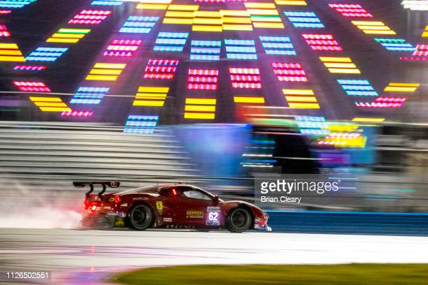 The Ferrari 488 GTE of Davide Rigon, of Italy, Miguel Molina, of Spain, Alessandro Pier Guidi, of Italy, and James Calado, of Great Britain, races...