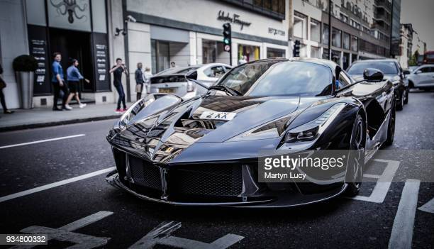The Ferrari LaFerrari seen in Knightsbridge London The hybrid supercar of which 499 were built was valued at over £1 Million altho some have sold for...