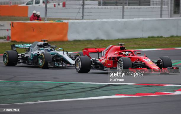 the Ferrari of Sebastian Vettel and the Mercedes of Valtteri Bottas during the tests at the BarcelonaCatalunya Circuit on 27th February 2018 in...