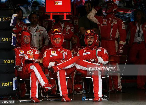 The Ferrari Pit team watch the TV screen in the pits during the European Grand Prix at Nurburgring on July 22 2007 in Nurburg Germany