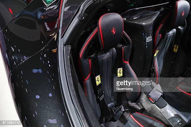 The Ferrari prancing horse logo sits on seating headrests inside the LaFerrari Aperta automobile, produced by Ferrari NV, during the second press day...