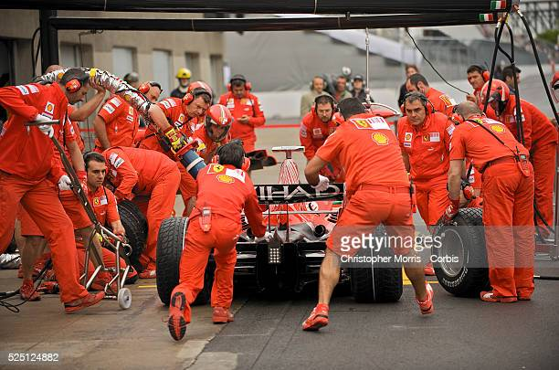 The Ferrari team pit crew works on Felipe Massa's race car during a practice session at the Formula One Grand Prix of Canada at the Gilles Villeneuve...