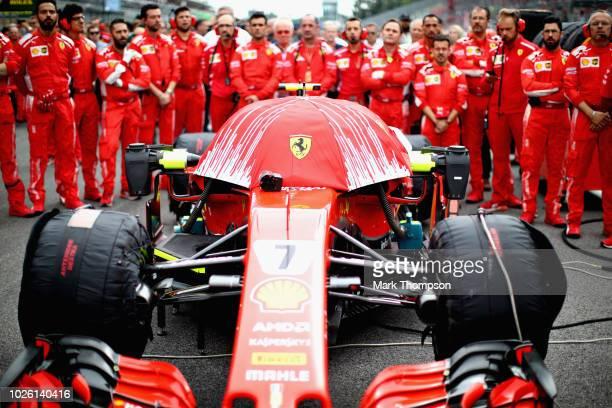 The Ferrari team prepare the car of Kimi Raikkonen of Finland driving the Scuderia Ferrari SF71H on the grid before the Formula One Grand Prix of...