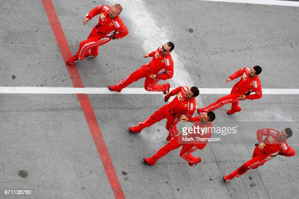 The Ferrari team run down the pit lane to celebrate the race win of Sebastian Vettel of Germany and Ferrari during the Canadian Formula One Grand...
