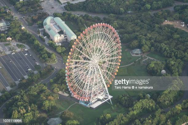 The ferris wheel in Kasai Rinkai Park in Tokyo in Japan sunset time aerial view from airplane