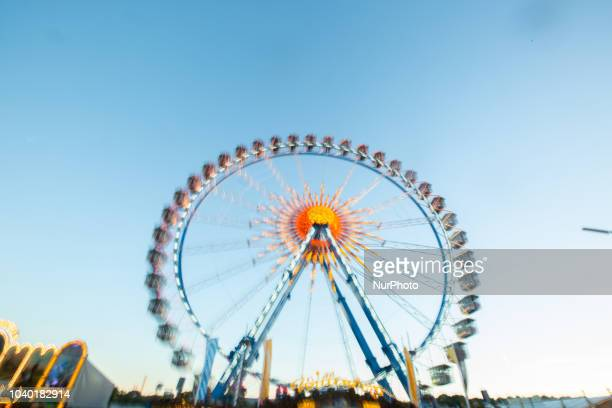 The ferris wheel seen with a long time exposure on Day 4 of the Oktoberfest The Oktoberfest or Wiesn in Bavarian is the world's largest Volksfest It...