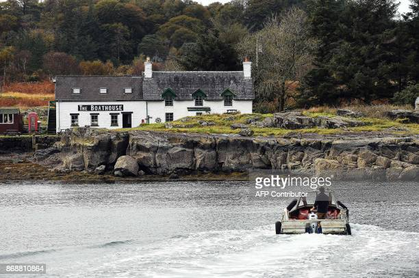 The ferry drives across to the Isle of Ulva off Scotland's west coast on October 20 2017 When tycoons in helicopters began landing on Scotland's Isle...