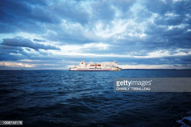 The ferry Mont SaintMichel of maritime transport company Brittany Ferries that links Portsmouth to Ouistreham arrives on July 30 2018 in Ouistreham...