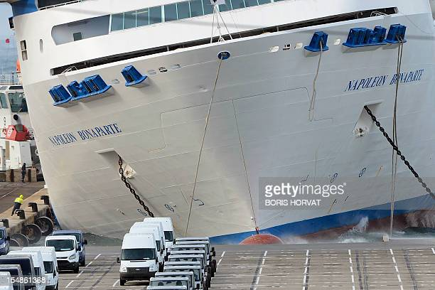 The ferry NapoleonBonaparte of French SNCM company which manages Mediterranean sea transport shuttles tilts to the side against a quay on October 28...
