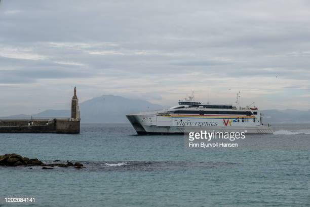 the ferry that runs between tarifa in spain and tanger in marocco entering the harbour of tarifa - finn bjurvoll stock pictures, royalty-free photos & images