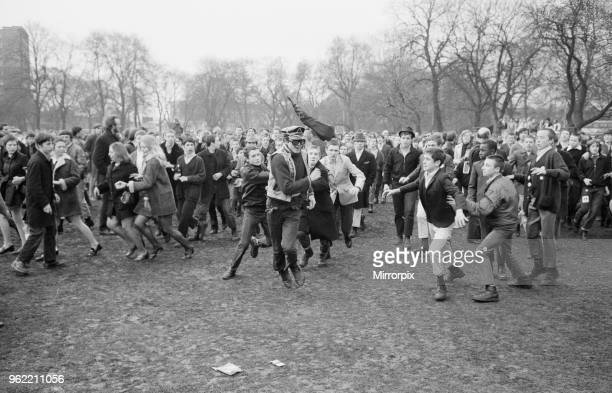 The 'Festival of Life' meeting arranged by the CND held at Victoria Park in Bethnal Green East London Picture shows A lone greaser runs away from a...