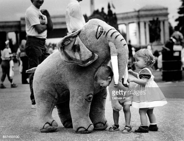 The Festival of Mountains andPlains Jessie Yager ducks under the trunk of a hugh stuffed elephant as Lindsay Plutt stands near by The elephant was...