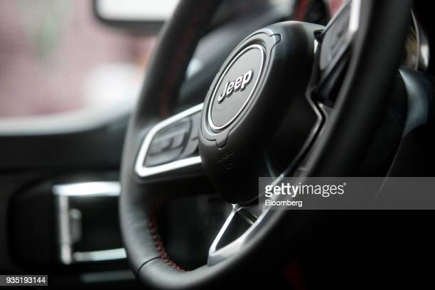 The Fiat Chrysler Automobiles NV Jeep brand logo is displayed on the steering wheel of the Jeepster concept vehicle during a media event ahead of the...