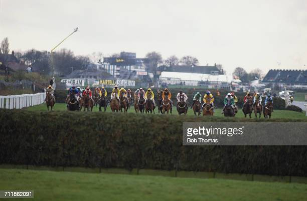 The field approaching Becher's Brook during the Grand National at Aintree Racecourse Liverpool 7th April 1990