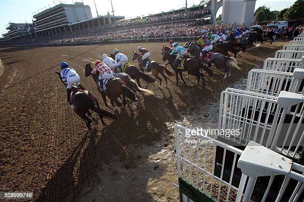 The field breaks out of the starting gate during the 142nd running of the Kentucky Derby at Churchill Downs on May 07 2016 in Louisville Kentucky