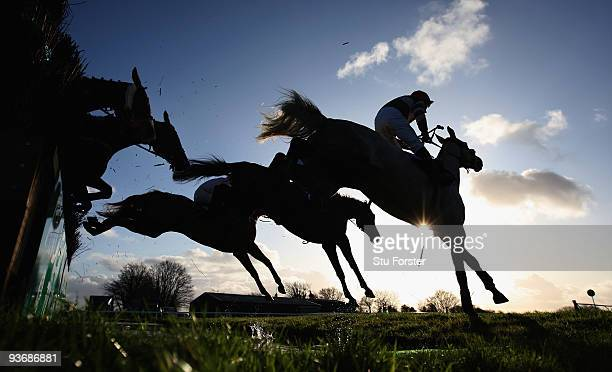 The field clear the water jump during the Weatherby's bank silver buck handicap chase at Wincanton Racecourse on December 3 2009 in Wincanton England