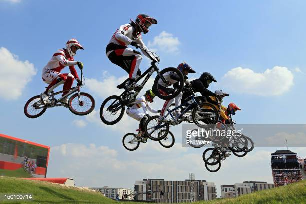 The field clears a jump as they race in the Men's BMX Cycling Semi Finals on Day 14 of the London 2012 Olympic Games at the BMX Track on August 10,...
