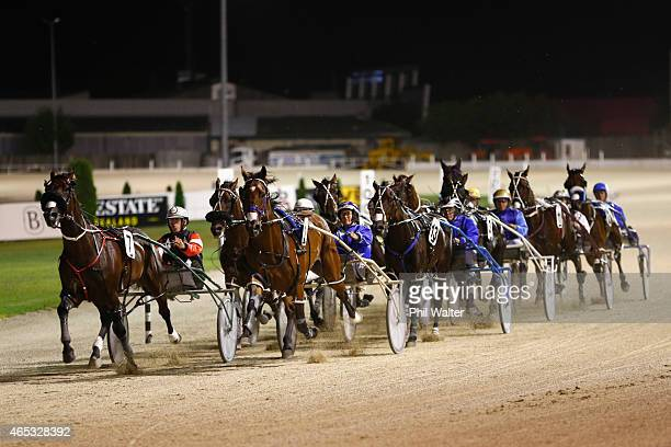 The field comes around on the first lap during the New Zealand Trotting Cup at Alexandra Park on March 6 2015 in Auckland New Zealand